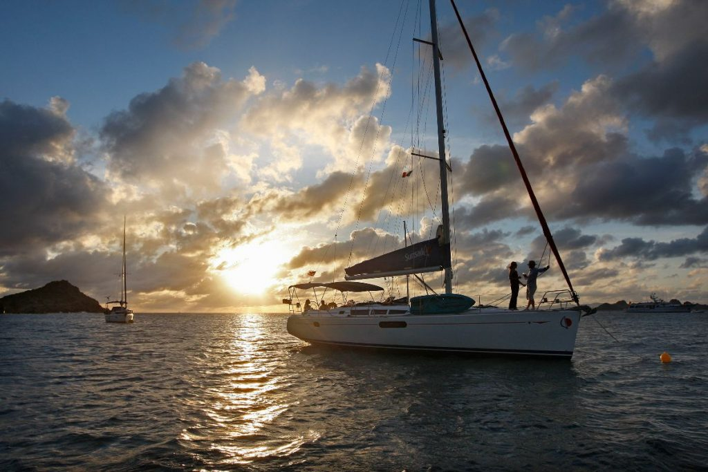 Sunsail yacht on the vast sea, holidays, sunset, sailing