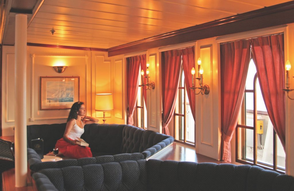woman enjoying her sailing experience on star clippers